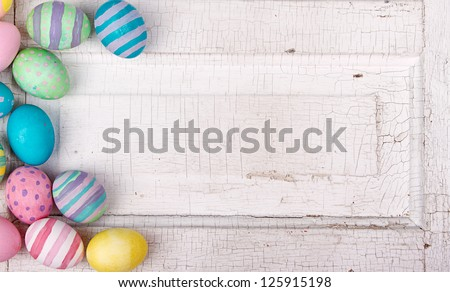 Easter eggs painted in pastel colors on a white cracked antique background - stock photo