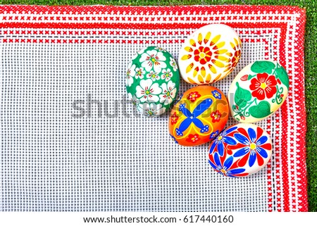 Easter eggs with a pattern of flowers on a tablecloth with hand embroidery
