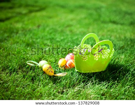 Easter Eggs with Basket on the Grass