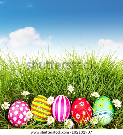 Easter Eggs with flower on Fresh Green Grass with blue sky