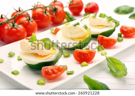 Easter eggs with mayonnaise and spring onions and cherry tomatoes