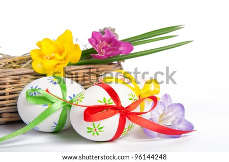 Easter eggs with ribbons in a basket