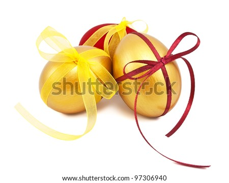 easter eggs with ribbons on white background