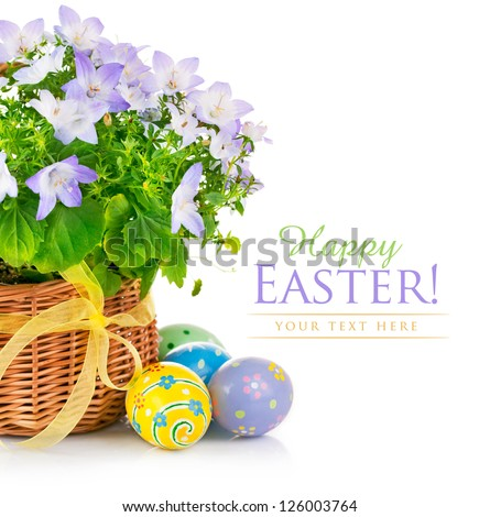 easter eggs with spring flower in the basket - stock photo