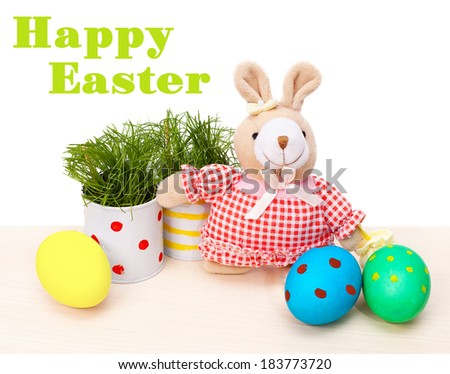 Easter eggs with teddy rabbit and grass on white background - stock photo