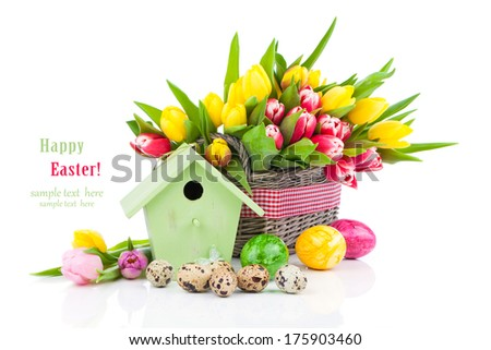 Easter eggs with tulips flowers and birdhouse, on a white background - stock photo