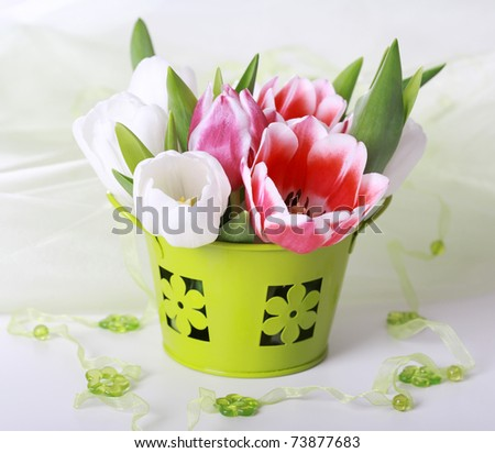 Easter eggs with tulips for spring table decoration - stock photo