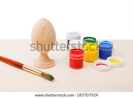 Easter eggs wooden on table with paints - stock photo