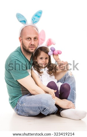 Easter father and daughter holding colorful eggs  isolated on white background - stock photo