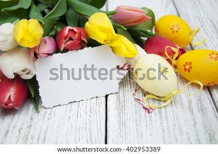 Easter gift card tulips easter eggs stock photo 402953389 easter gift card with tulips and easter eggs on a wooden background negle Choice Image