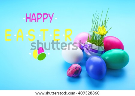 Easter greeting card. Colorful eggs  on blue background - stock photo