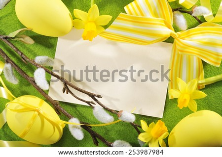 Easter greeting card with copy space, yellow easter eggs, narcissus on tablecloth - stock photo