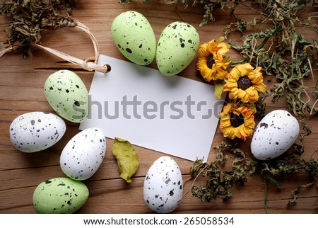 Easter greeting card with decorated eggs around - stock photo