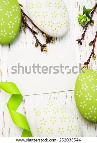 Easter greeting card with easter eggs on a old wooden background