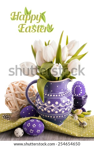 Easter greeting card with white tulips in purple jug and matching Easter eggs. Top of the picture is isolated on white, with space for your text - stock photo