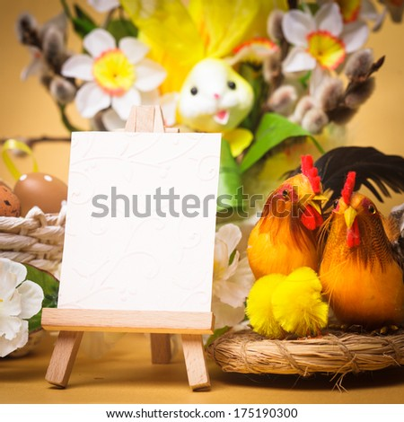Easter greetings with eggs, flowers and chiken - stock photo