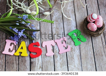 Easter. Happy Easter. Easter word. Easter letters. Easter eggs. Easter wooden background.  - stock photo