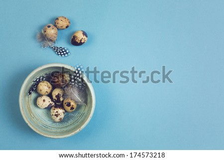 Easter holiday background with quail eggs over blue background