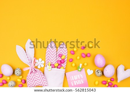 Easter holiday creative background eggs fabric stock photo easter holiday creative background with eggs fabric bunny gift bags with candies negle Choice Image