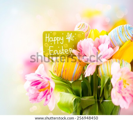 Easter Holiday flowers bunch with greeting card. Colorful tulips flowers bouquet decorated with colourful eggs. Easter art design. Springtime - stock photo