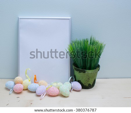 Easter Holidays! White blank paper in a frame with Easter eggs