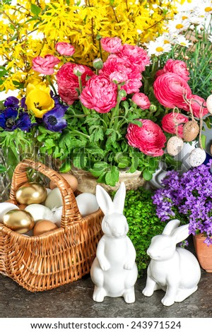 Easter home decoration with fresh spring flowers, bunny and eggs. Holidays background - stock photo