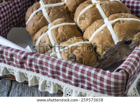 easter hot cross buns in basket  - stock photo