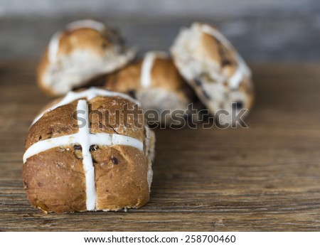Easter hot cross buns on wooden background - stock photo