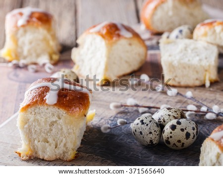 Easter Hot Cross Buns on wooden background.selective focus. - stock photo