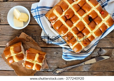 Easter Hot Cross Buns, overhead scene on rustic wood background - stock photo