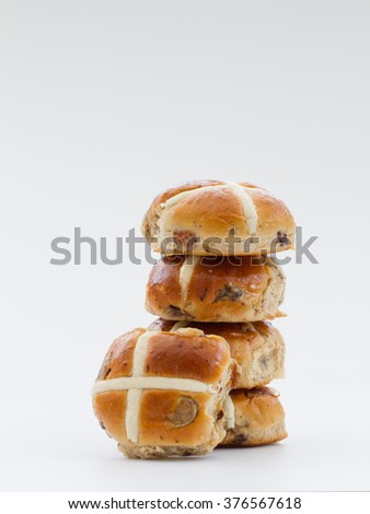Easter Hot Cross Buns stacked up and isolated on a white background. - stock photo