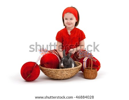Easter image: smiling little girl with Easter bunny isolated on white background. - stock photo