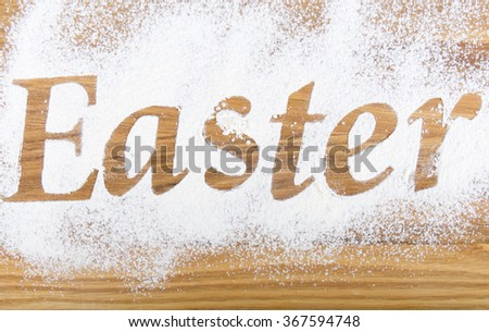 Easter inscription on the wooden background