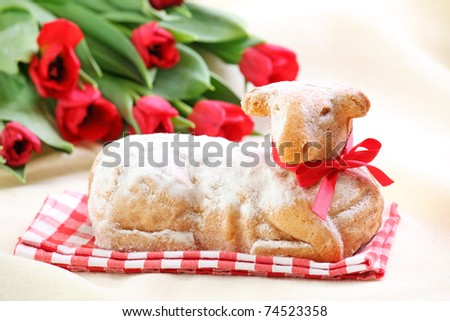 Easter lamb cake and red tulips on white background - stock photo