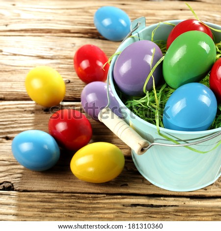 easter metal plate and color of eggs on worn wooden desk