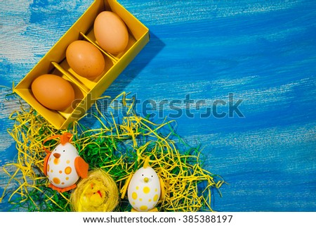 Easter motives on a blue wooden background, selective focus