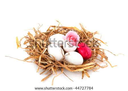 easter nest with rose and chocolate egg