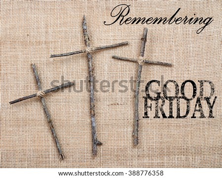Easter or Good Friday image of three handmade crosses made out of twigs or sticks tied with twine on a rough textured background made of burlap. Text added. - stock photo