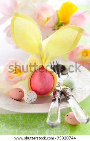 Easter place setting with flowers and eggs - stock photo