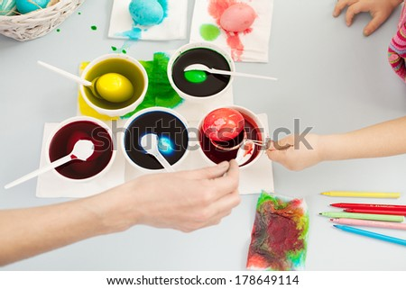 easter preparation with colorful dyes and eggs - stock photo