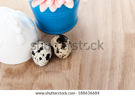 Easter setting with quail eggs and blue bucket  - stock photo