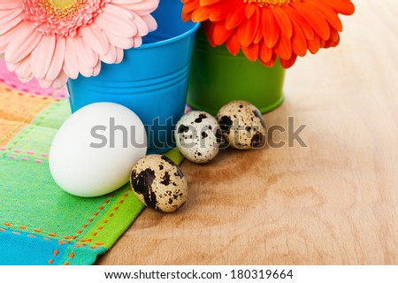 Easter setting with quail eggs and pink and orange gerberas  - stock photo