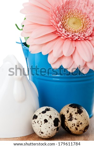 Easter setting with quail eggs and pink gerbera  - stock photo