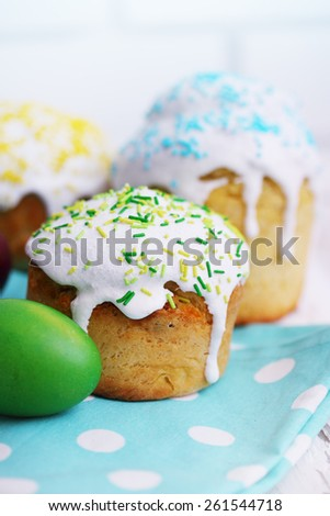 Easter still life. Little Easter cakes and painted eggs - stock photo