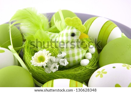 easter still life with color eggs and chicken on a ceramic plate - stock photo