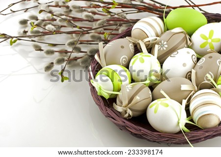 Easter still life with colorful eggs  in  wicker  basket - stock photo