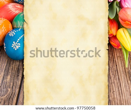 Easter still life with empty greeting card for your text - stock photo