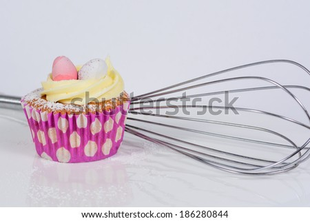 Easter Style Cupcakes  with a whisk in the background - stock photo