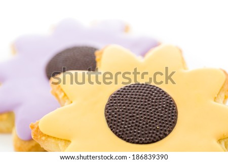 Easter sugar cookies in shape of flower with chocolate icing.