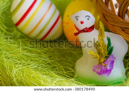 Easter sugar lamb and eggs on green grass